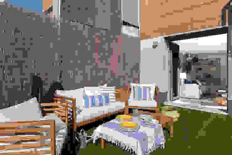 Reforma y Amueblamiento en sótano de vivienda unifamiliar adosada en Tres Cantos Jardines de estilo mediterráneo de itta estudio Mediterráneo