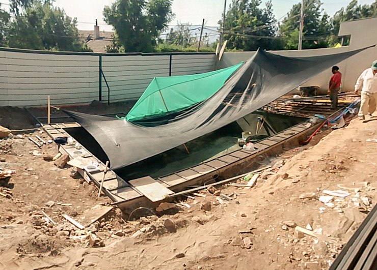 Proteccion solar homify Piscinas de jardín Concreto reforzado Azul