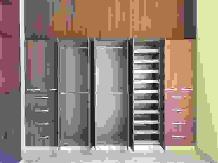 CLOSET´S EN MELAMINA La Central Cocinas Integrales S.A de C.V Vestidores y closetsAlmacenamiento