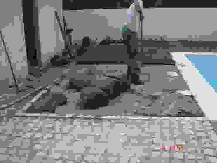 Moradia em Folgosa: Jardins  por Viveiros da Boa Nova, Lda,Moderno