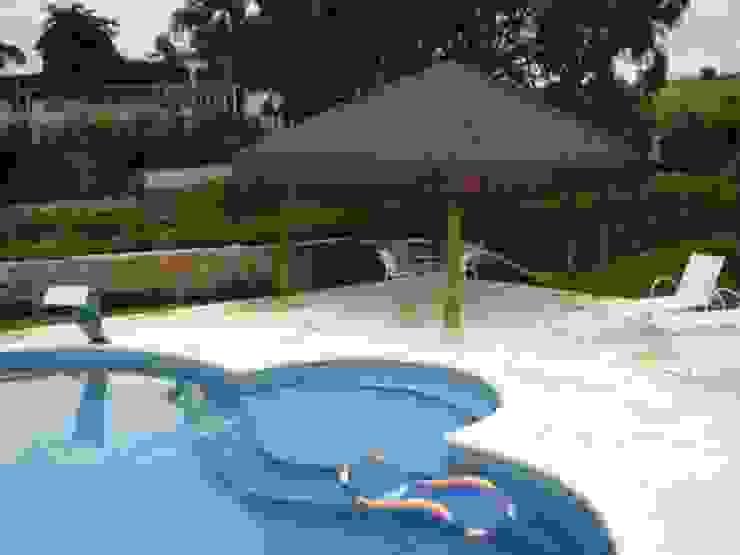 GAZEBO EM MADEIRA TRATADA:  tropical por Tropical Ambientes e Lazer,Tropical  de madeira e plástico