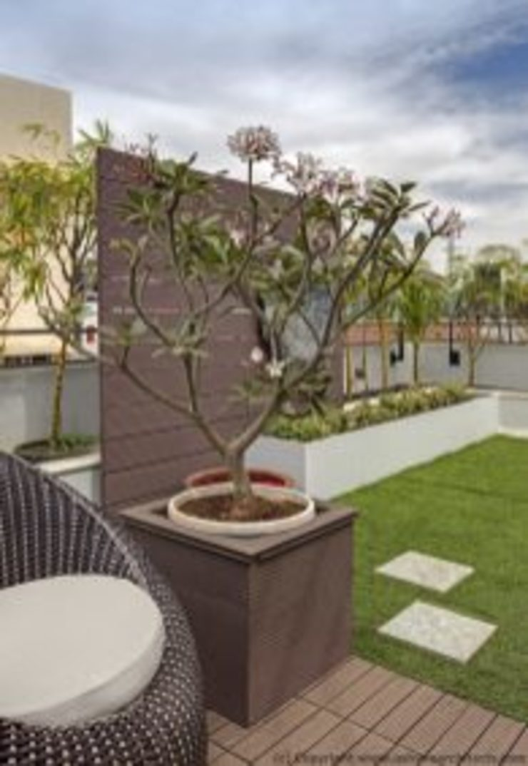 Striking House Designs Terrace Garden: 40×60, 4BHK Asian style balcony, veranda & terrace by Ashwin Architects In Bangalore Asian