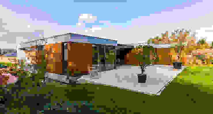 achtergevel overhoeks van 3d Visie architecten Modern Beton