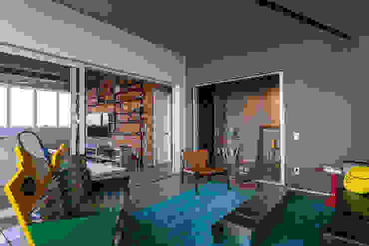 Salas de estilo industrial de Nautilo Arquitetura & Gerenciamento Industrial