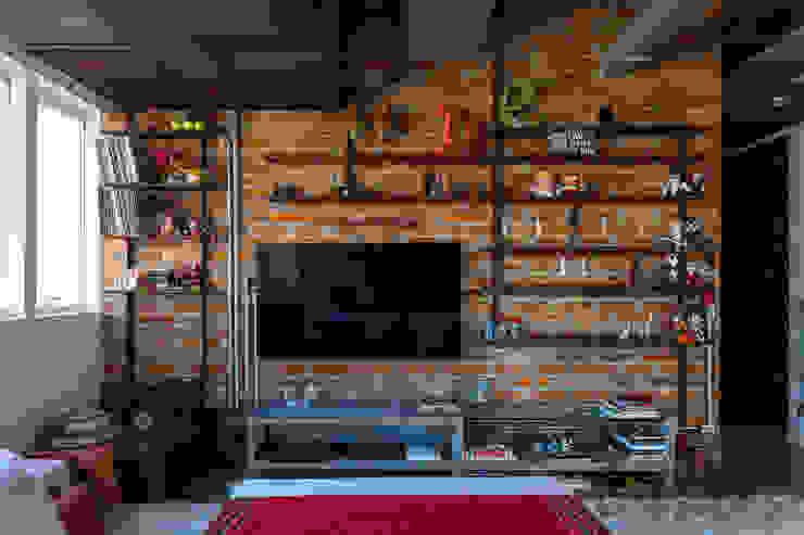 Salas de estilo industrial de Nautilo Arquitetura & Gerenciamento Industrial Concreto