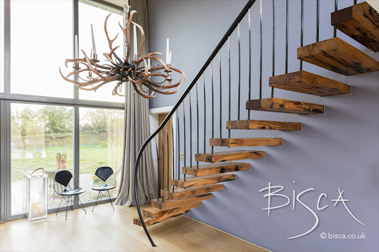 Flamed oka cantilevered staircase by Bisca Staircases Rustic Wood Wood effect