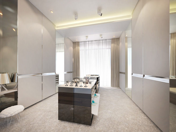 Walk-in closet:  Dressing room by Dessiner Interior Architectural,