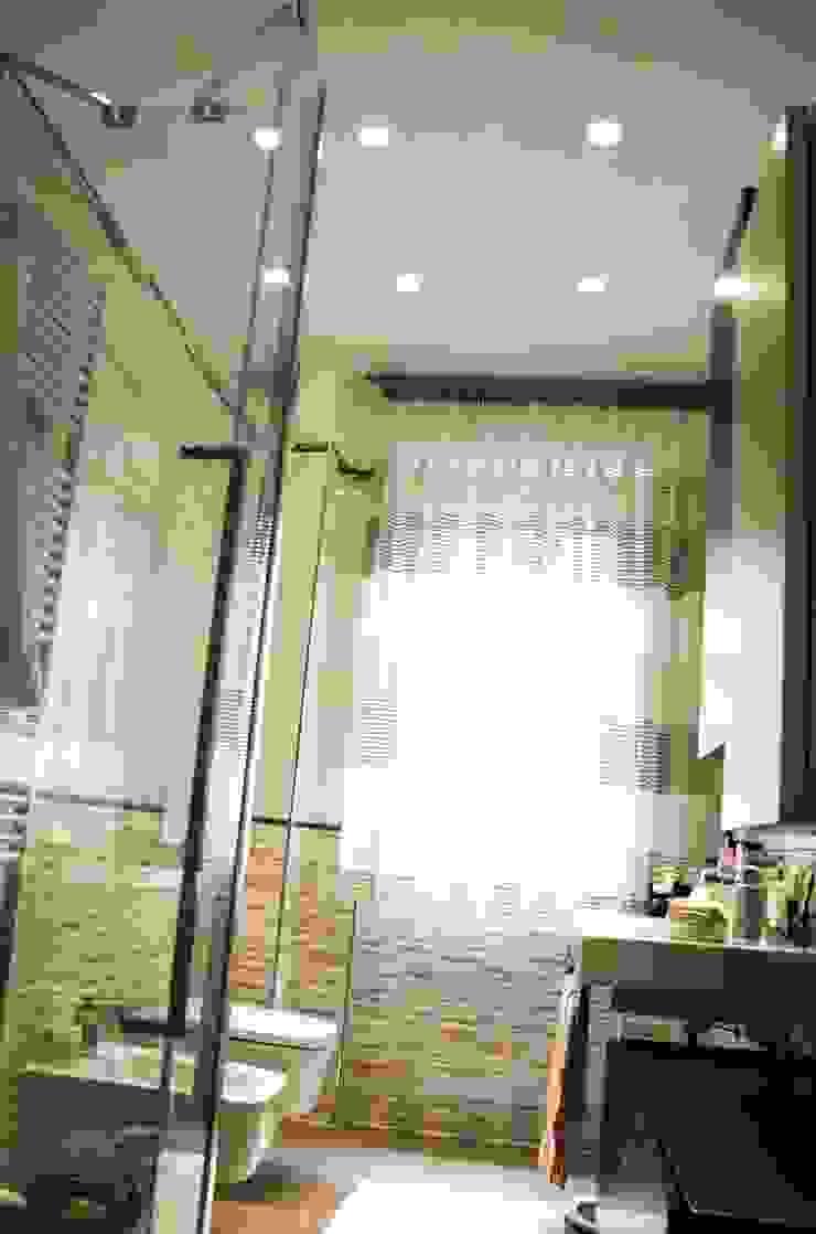 Calore e Design Bagno moderno di Studio ARCH+D Moderno