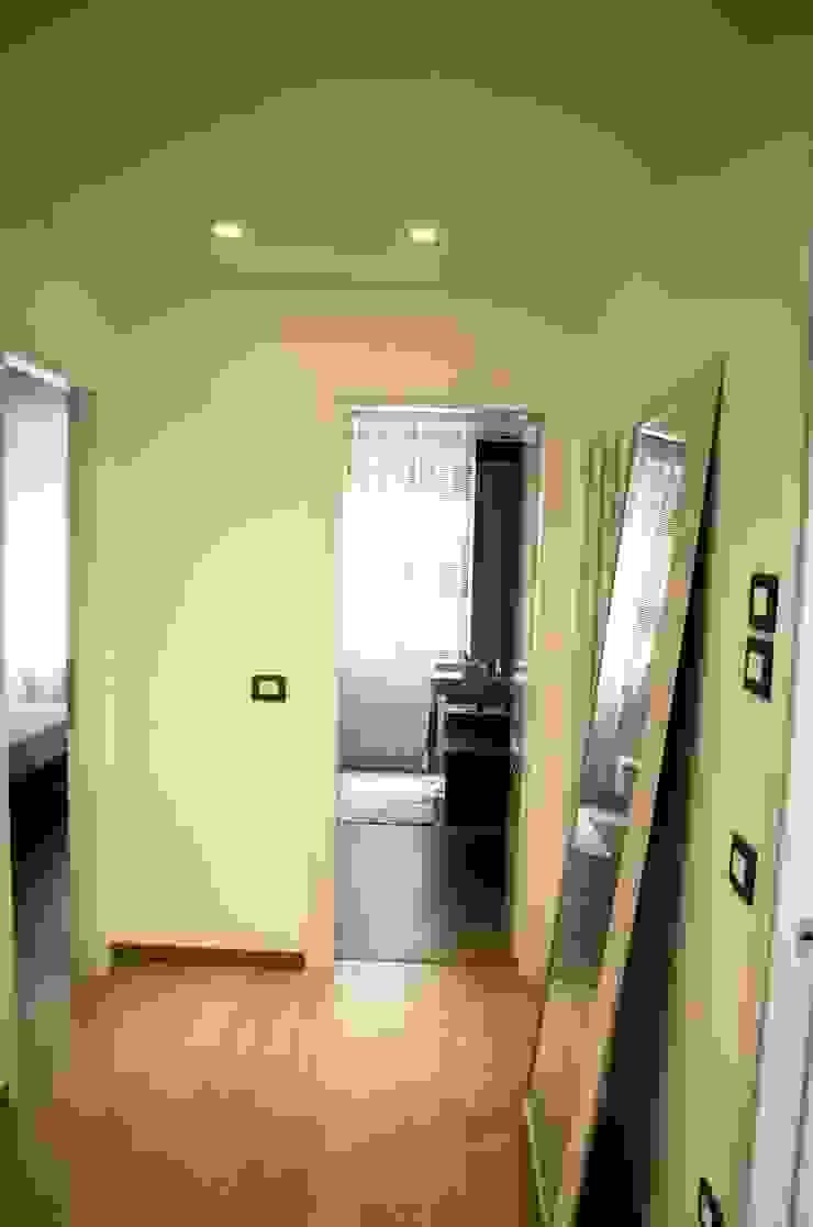 Calore e Design Ingresso, Corridoio & Scale in stile moderno di Studio ARCH+D Moderno