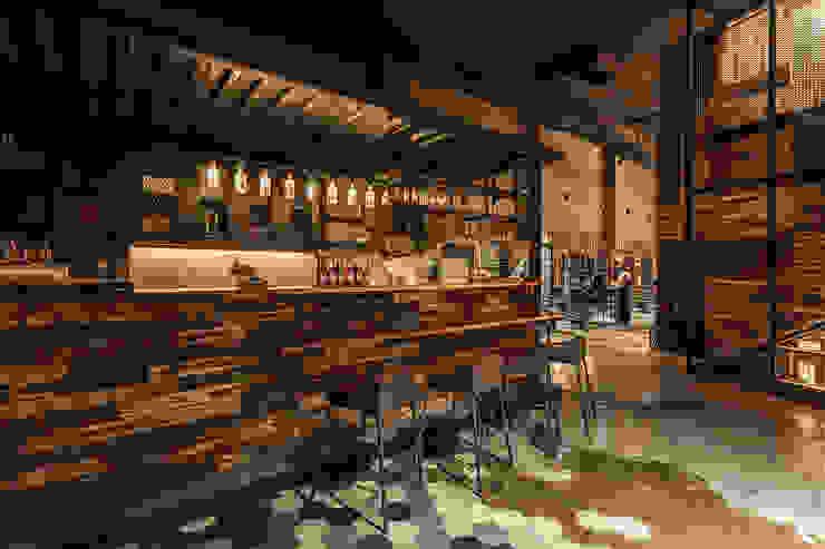 舒服的吧檯和醒目的展示櫃 根據 漢玥室內設計 工業風 大理石