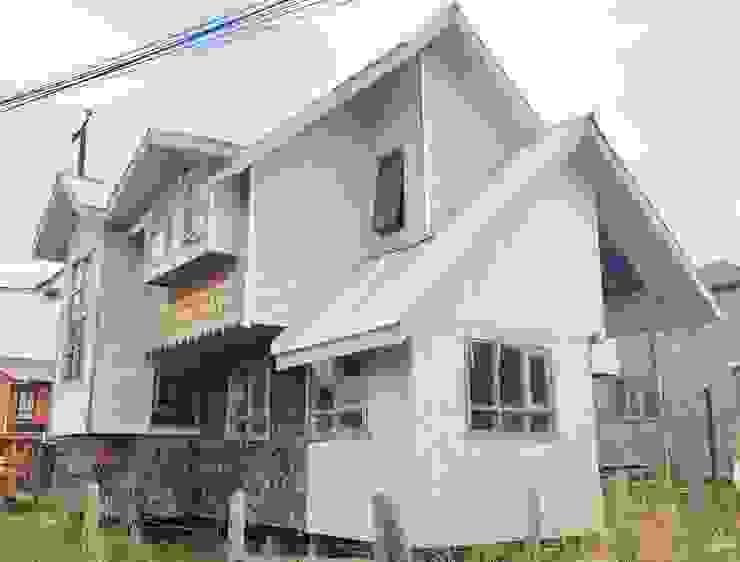 AMPLIACIÓN VIVIENDA UNIFAMILIAR – ACHAO, CHILOE Casas de estilo rural de GerSS Arquitectos Rural Madera Acabado en madera