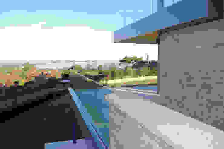 Family Home in Swanage, Dorset David James Architects & Partners Ltd Modern balcony, veranda & terrace