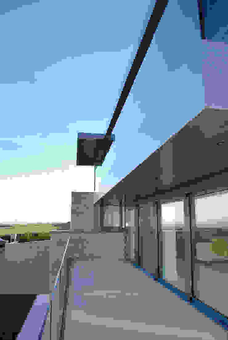 Family Home in Swanage, Dorset Modern balcony, veranda & terrace by David James Architects & Partners Ltd Modern