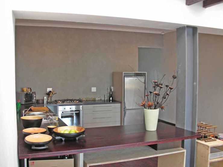 open plan kitchen by Till Manecke:Architect Asian