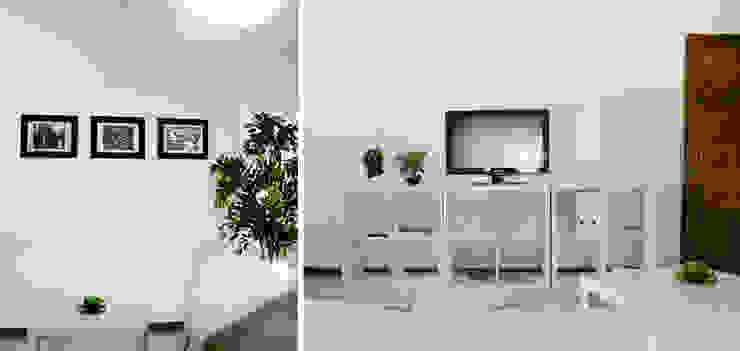 La sala rinnovata con il bianco.: Soggiorno in stile  di Rifò
