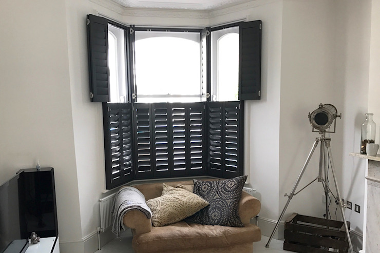 Tier on Tier Shutters in the Living Room Plantation Shutters Ltd Industrial style living room Wood Black