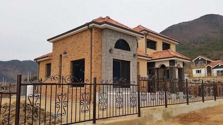 Country style houses by 운화건축사사무소 Country