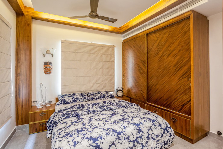 The mural apartment Tropical style bedroom by S Squared Architects Pvt Ltd. Tropical Plywood