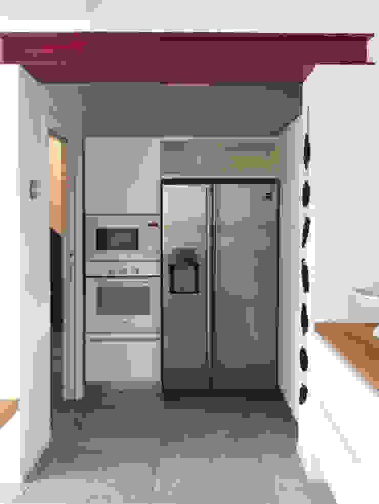 Casa con corte Cucina moderna di atelier architettura Moderno