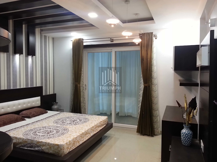 Masterber Room Bed: modern  by TRIUMPH INTERIORS, Modern