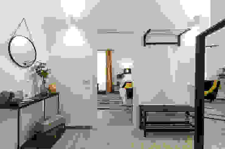 Casa MS Architrek Ingresso, Corridoio & Scale in stile moderno