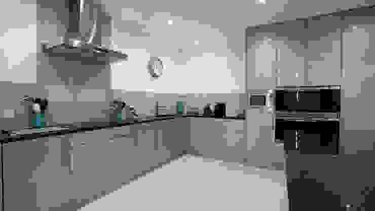 Gloss blue kitchen cupboards with stainless steel hardware. Modern Kitchen by Cleveland Kitchens Modern