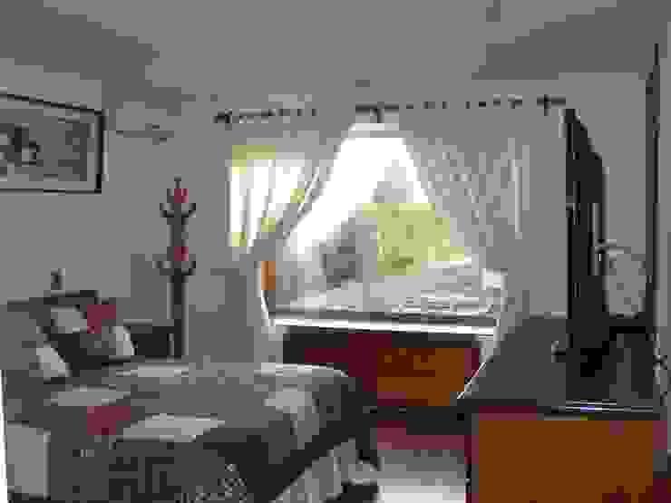 Dormitorio 3 Dormitorios de estilo colonial de homify Colonial Madera Acabado en madera