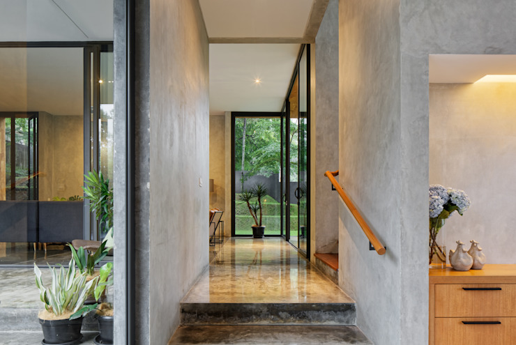 House of Inside and Outside Tropical style corridor, hallway & stairs by Tamara Wibowo Architects Tropical Concrete
