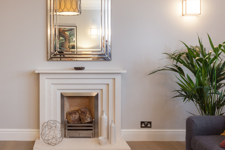 Art Deco style fireplace surround in limestone with eclectic furnishings Timothy James Interiors Eclectic style living room Grey