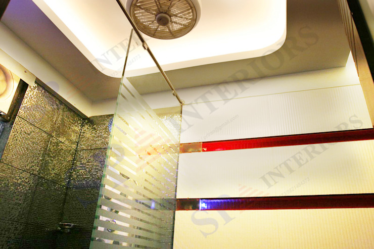 Sagar bajaj Modern bathroom by SP INTERIORS Modern