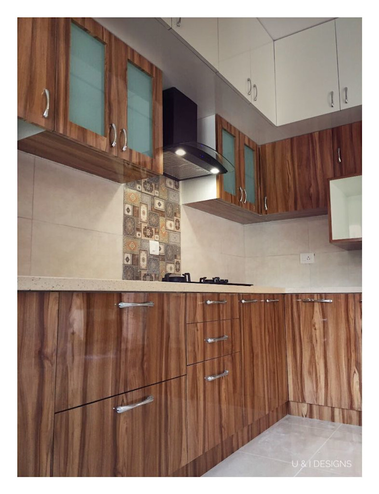 Kitchen by U and I Designs Modern