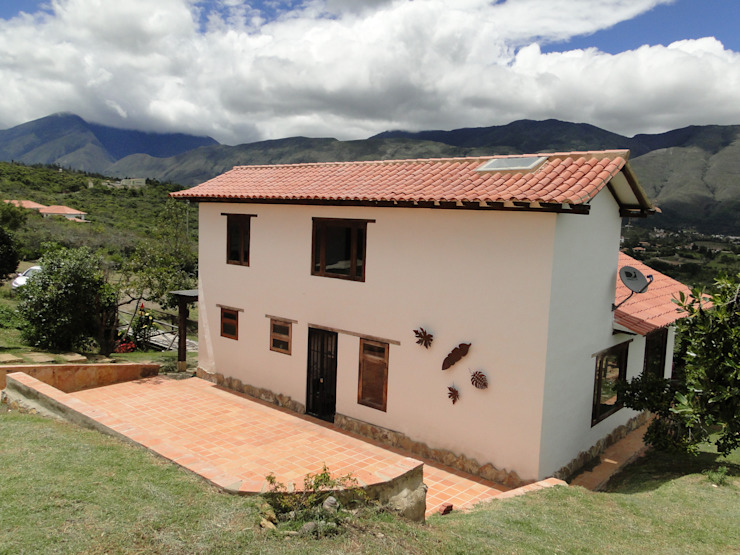 Casa De Campo El Cucharal de Pro Escala Arquitectos SAS Clásico