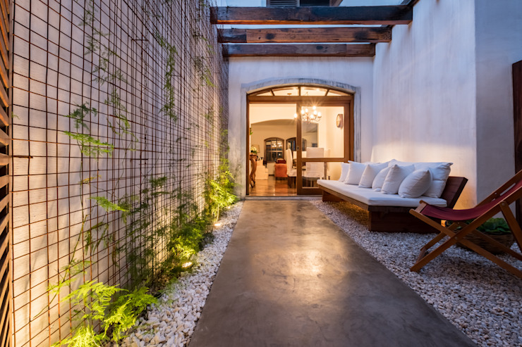 QOZ Arquitetos Modern conservatory