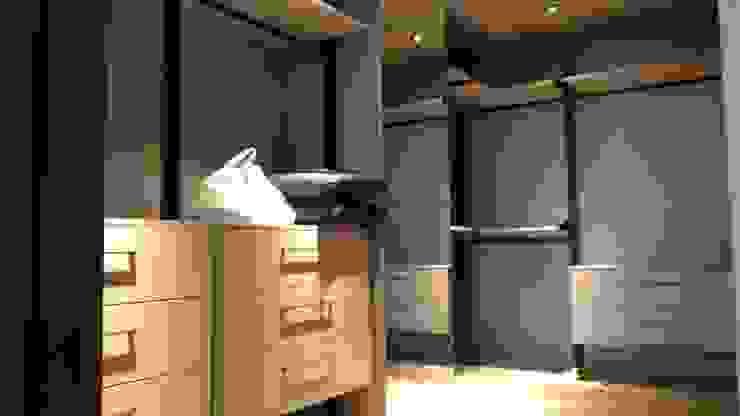 Vestidores y placares de estilo moderno de 勻境設計 Unispace Designs Moderno