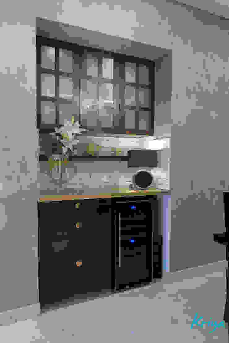 Modern dining room by KRIYA LIVING Modern