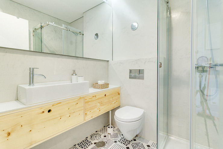 Apartamento da Alegria Casas de banho escandinavas por Homestories Escandinavo
