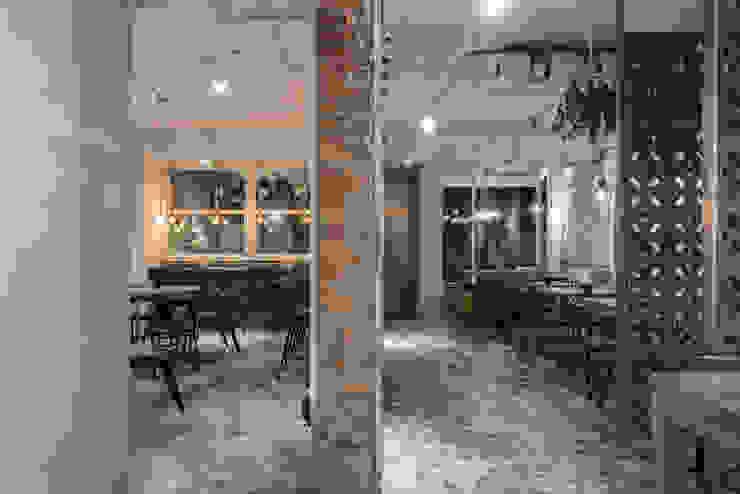 Dining area 根據 湜湜空間設計 隨意取材風 磚塊