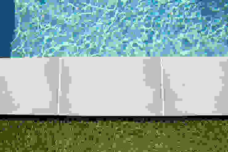 by Oplus piscines Minimalist Reinforced concrete