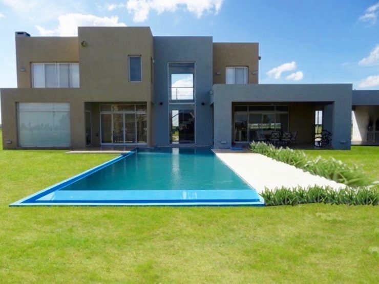 por Estudio Dillon Terzaghi Arquitectura - Pilar Minimalista Tijolo