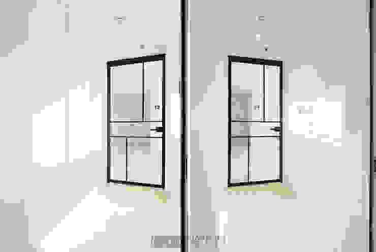 지승아이디 Pasillos, vestíbulos y escaleras de estilo minimalista