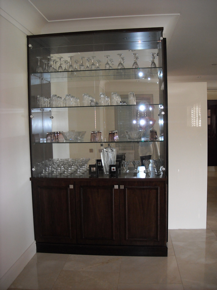Cocktail cabinet in Walnut, mirror and glass Eclectic style wine cellar by CKW Lifestyle Associates PTY Ltd Eclectic Wood Wood effect