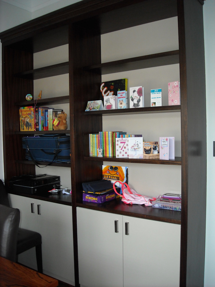 Bookshelves in study Eclectic style study/office by CKW Lifestyle Associates PTY Ltd Eclectic Solid Wood Multicolored