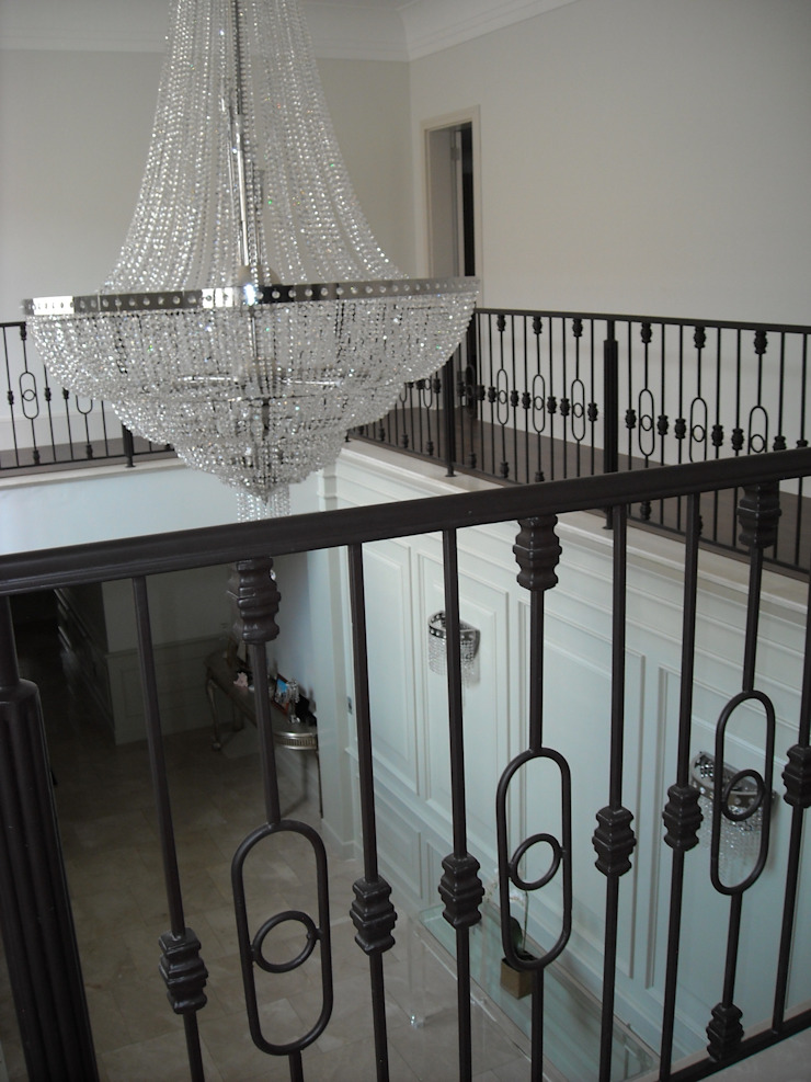 Balustrades, wall panels and custom crystal chandeliers Eclectic corridor, hallway & stairs by CKW Lifestyle Associates PTY Ltd Eclectic Iron/Steel