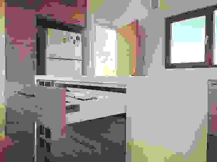 Mueble isla cocina. Vivienda Lt37 Premium 125m2 Fundo Loreto de Territorio Arquitectura y Construccion - La Serena Moderno Compuestos de madera y plástico