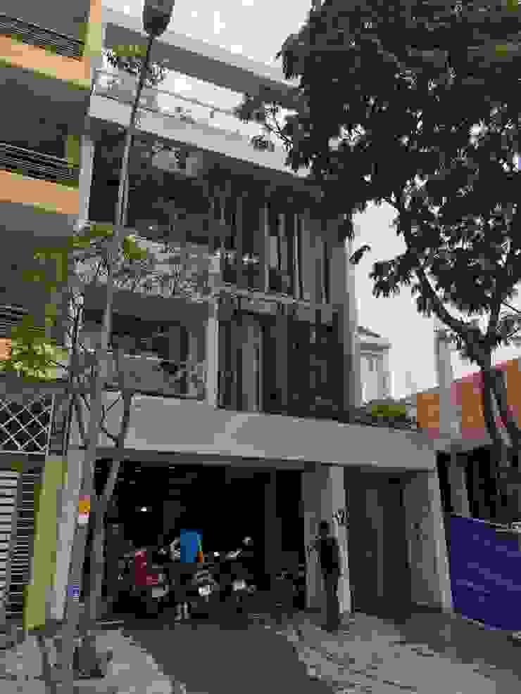 Mê mẫn trước ngôi nhà phố 4 tầng 7x14m tuyệt đẹp tại quận 7. Nhà phong cách châu Á bởi Công ty TNHH TK XD Song Phát Châu Á Đá hoa