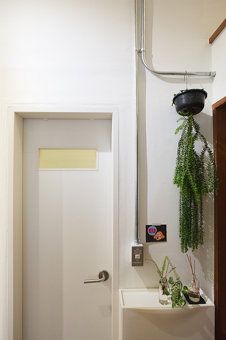 미우가 디자인 스튜디오 Baños de estilo rústico