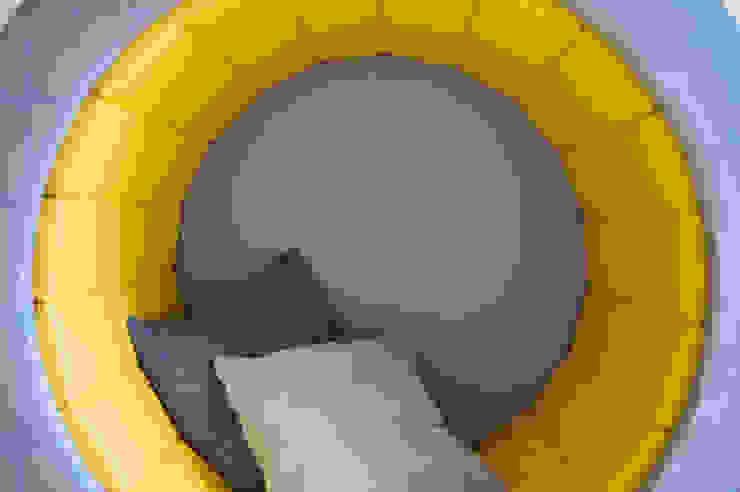 Circular, padded reading seat with cushions Tigerplay Scandinavian style nursery/kids room Yellow