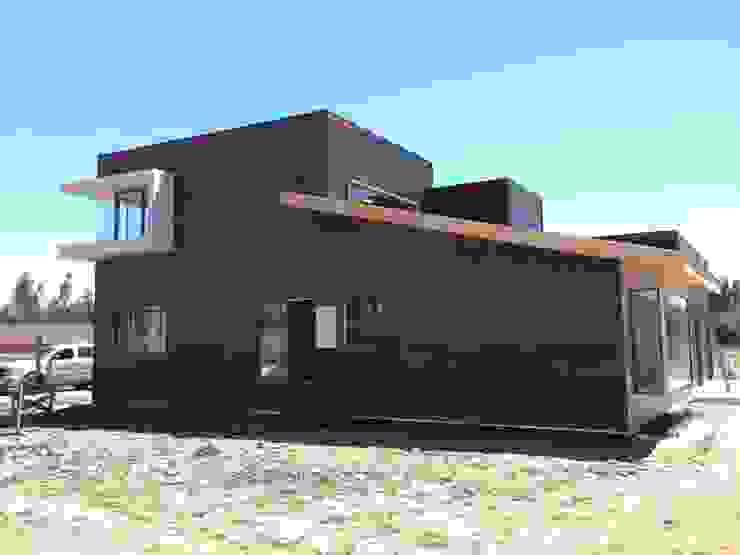 Construcción de Casa Munchmeyer Rumpf por Arqbau de Arqbau Ltda. Moderno Compuestos de madera y plástico