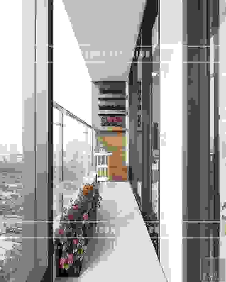 Thiết kế phong cách hiện đại thanh lịch với tông màu trắng Hành lang, sảnh & cầu thang phong cách hiện đại bởi ICON INTERIOR Hiện đại
