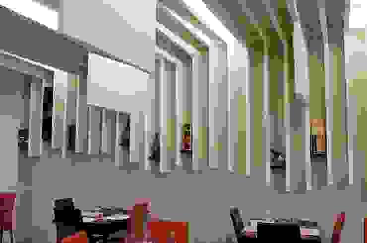 <q> Lo Scalco Grasso</q>- Osteria Contemporanea Negozi & Locali commerciali moderni di Studio di Architettura IATTONI Moderno
